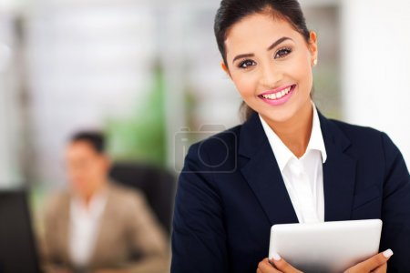 Photo for Young attractive business woman holding a tablet computer - Royalty Free Image