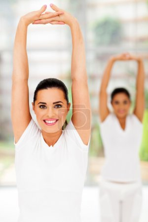 two young females doing yoga exercise