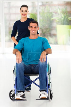 Handicapped man and caring wife at home
