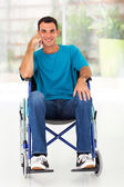 Happy disabled man sitting on wheelchair