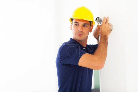 cctv technician adjusting camera angle