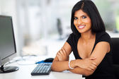 pretty hispanic businesswoman in office