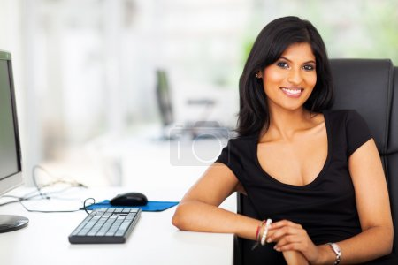 attractive female executive in her modern office