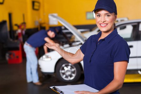 Friendly female vehicle service center worker welcome