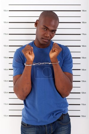 Photo for African american man got caught and arrested - Royalty Free Image