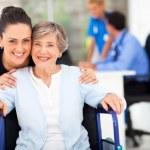 Caring adult daughter accompanying senior mother v...