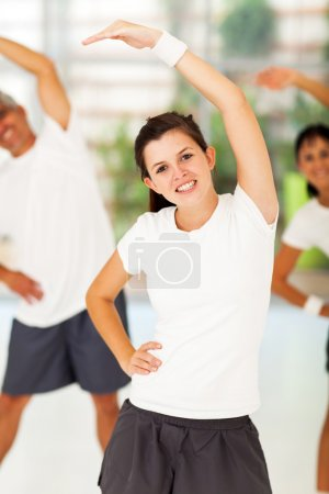 teenage girl exercising with parents