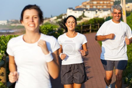 happy active family jogging