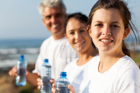 Fit family with water bottle after exercise