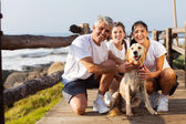 Sporty family and pet dog at the beach