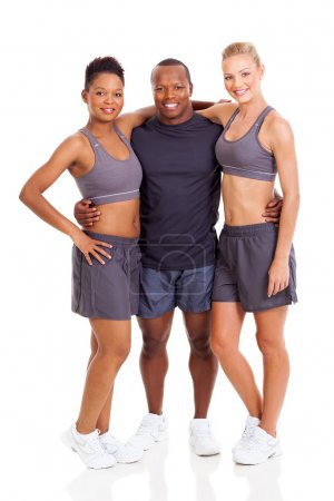group of smiling gym instructors