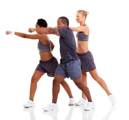 group of exercising karate