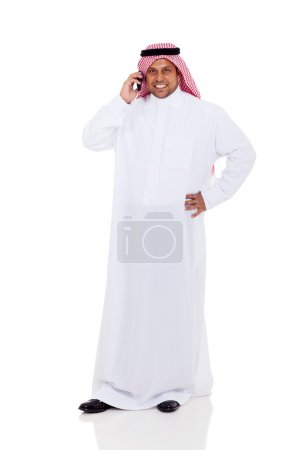middle eastern man talking on cell phone