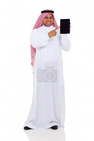 middle eastern man pointing at tablet computer