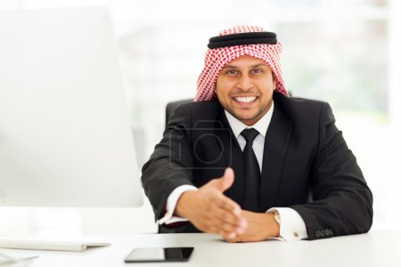 arabic businessman handshake
