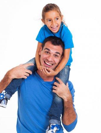 Photo pour Père ludique portant sa petite fille sur ses épaules isolé sur fond blanc - image libre de droit