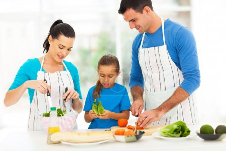 lovely family preparing food at home