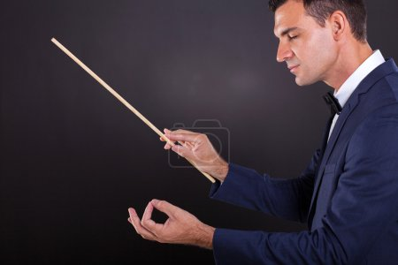 conductor with eyes closed