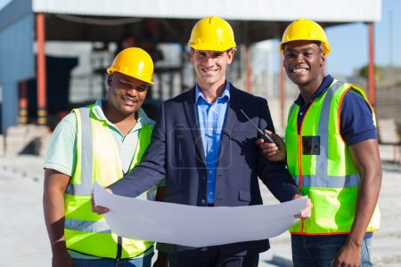 Photo for Cheerful man architect team on construction site - Royalty Free Image