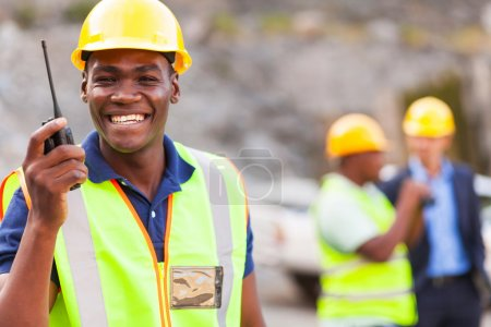 afro american mine worker with walkie talkie