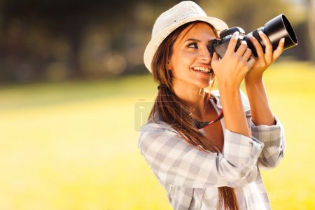 young female photographer taking pictures