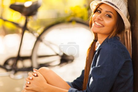 young fashion model sitting outdoors