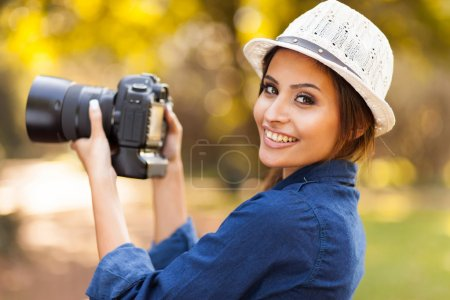 young woman learning to use camera