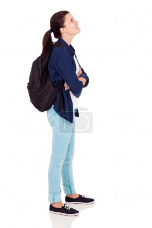 Female high school student looking up