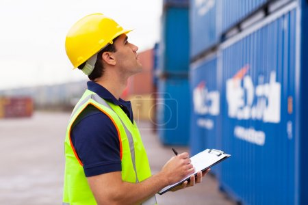 warehouse worker recording containers