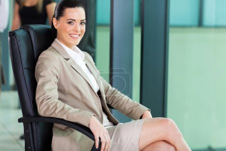 cute female corporate worker sitting in boardroom