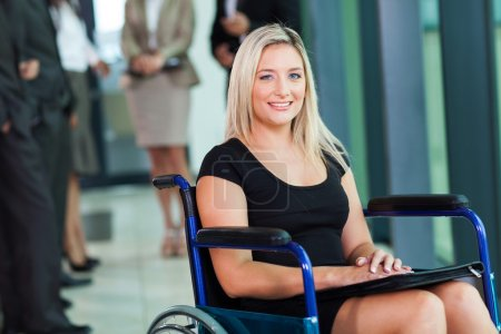 Photo for Attractive disabled businesswoman sitting in a wheelchair - Royalty Free Image