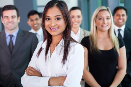 Photo for Beautiful young indian businesswoman and team in office - Royalty Free Image