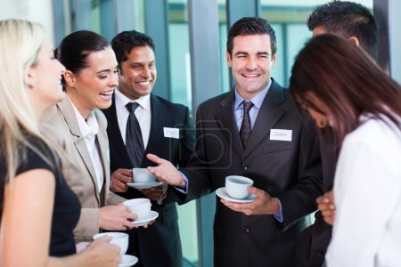 Photo for Funny businessman telling a joke during conference coffee break - Royalty Free Image