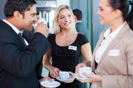 Photo for Group of business people having coffee break during seminar - Royalty Free Image
