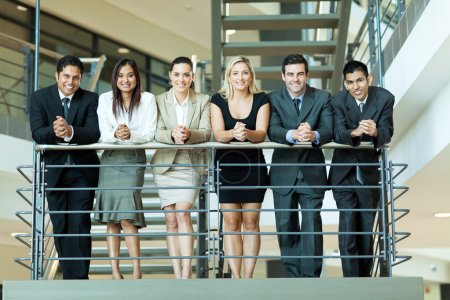 Photo for Group of business people standing by stairway - Royalty Free Image