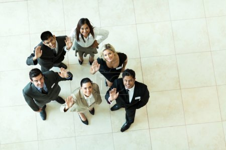 Overhead view of businesspeople waving