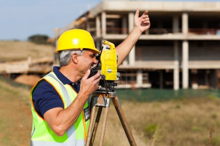 land surveyor talking on walkie talkie