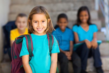 Photo for Pretty preschool girl with schoolmates on background - Royalty Free Image