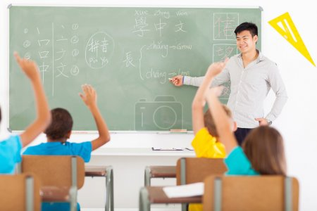 Educator teaching chinese language to primary kids