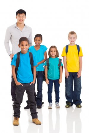 Young indian boy in front of classmates and teacher