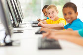 group of elementary school students in computer room