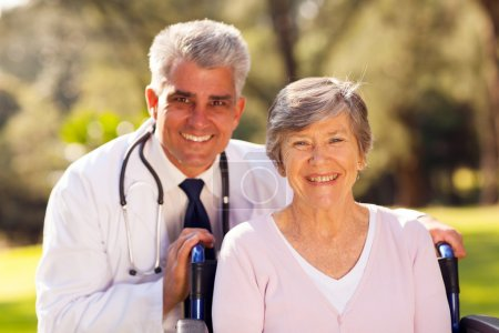 medical doctor with senior patient outdoors