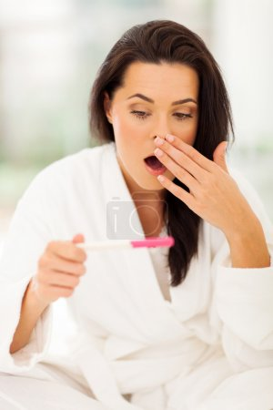 Photo for Young woman got shocked when her pregnancy test showing positive result - Royalty Free Image