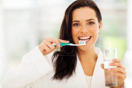 cute woman brushes her teeth
