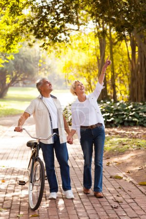 Photo for Happy middle aged couple enjoying being outdoors - Royalty Free Image