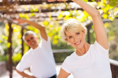 Photo for Active senior woman exercising with husband outdoors - Royalty Free Image