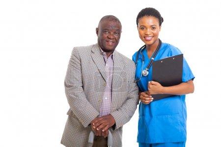 senior african american man with medical nurse