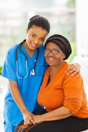 caring african nurse and senior patient