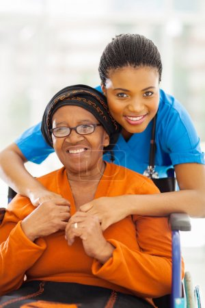 senior african disabled woman caregiver