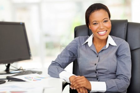 african businesswoman sitting in office